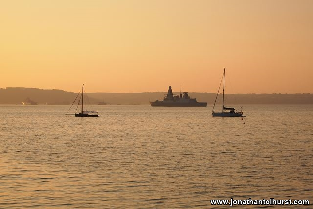 Sunset at Cawsand Beach with HMS Diamond
