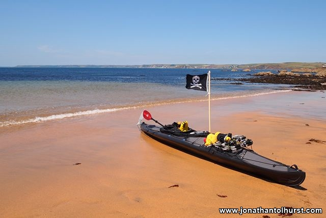 flying-the-jolly-roger-on-hope-cove-beach